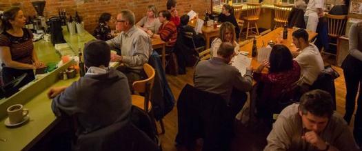 people eating inside Ravenous restaurant