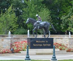 horse statue and welcome sign