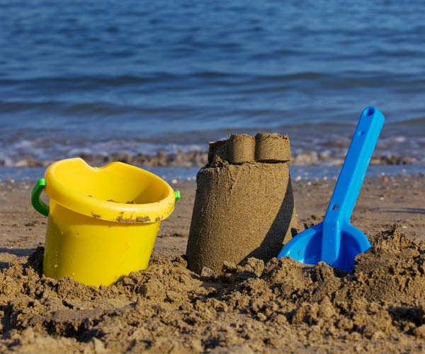 Beach pail, shovel and sand castle