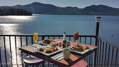 table with food in front of lake