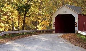 opening of a red covered bridge