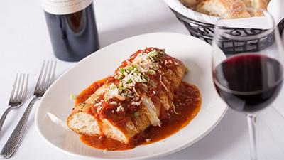 plate of italian food with red wine