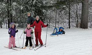 a family cross country skiing in winter