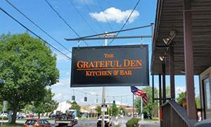 outdoor sign at the grateful den restaurant