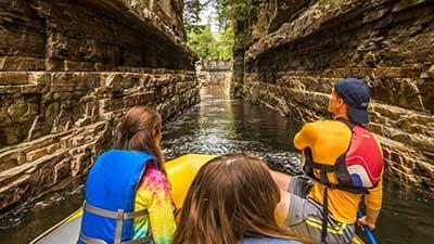 Three people floating down the river at Ausable Chasm