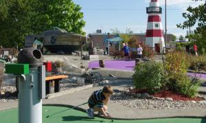 a boy mini golfing