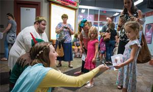 little girl getting autographs from actors