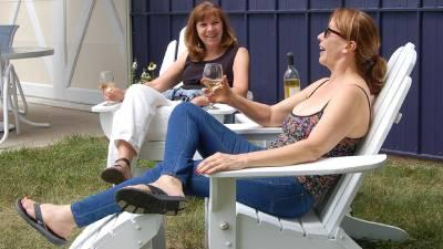 women wine tasting in chairs