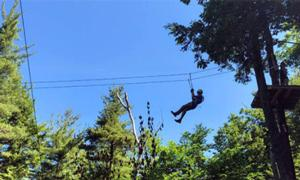 man on a zip line