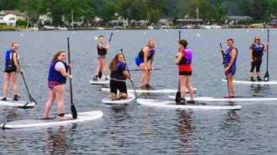 women stand up paddleboarding