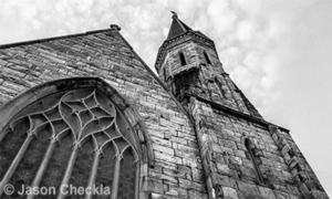 black and white photo of church facade and steeple