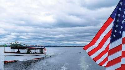 Adirondack Cruise on Saratoga Lake with an American Flag