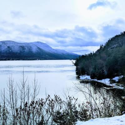 Adirondack winter scene with mountains and water