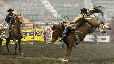 man riding a horse bareback