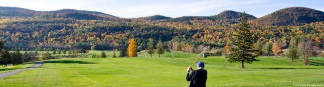man golfing in the fall