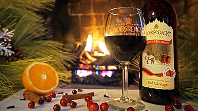 bottle and glass of wine in front of the fire