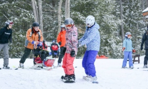 kids learning to snowboard at double h ranch