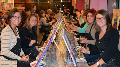 women painting at Saratoga paint & sip