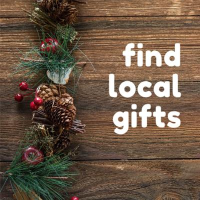 wooden background with pine cones and text that says find local gifts