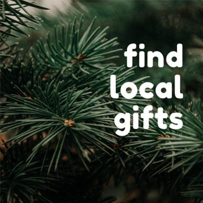 pine branches with text that says find local gifts