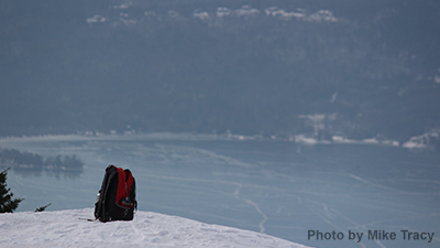 backpack on a mountain summit in the winter