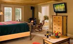 adirondack hotel room with a fireplace