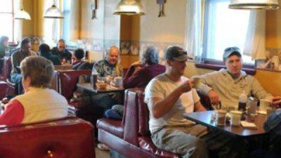 people eating inside a diner