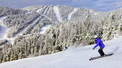 person downhill skiing at gore