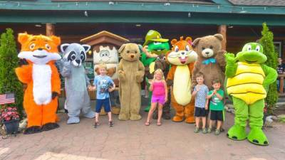 kids with animal costumed characters