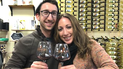 couple holding wine glasses at Adirondack Winery