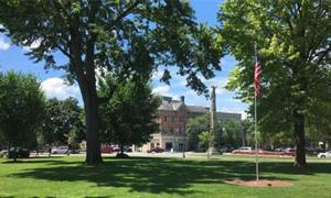 flag, monument, and a park in downtown glens falls
