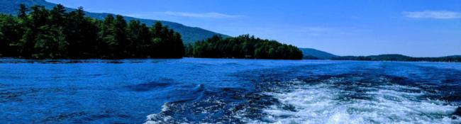 wake from boat and part of lake