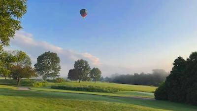 scenic landscape with balloon in the sky