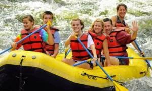 group whitewater rafting on yellow raft