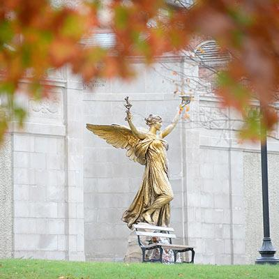 congress park statue with fall leaves