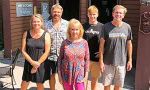 Five members of the Sutton Family standing outside the Farmstead Flatbread restaurant