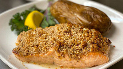 salmon on a plate with a baked potato