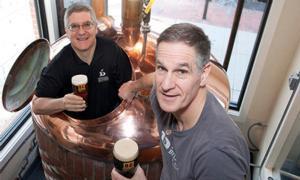 john and rick davidson each holding a beer