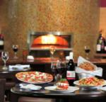 food, pizza, and wine on indoor restaurant table