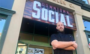 downtown social with new chef standing in front