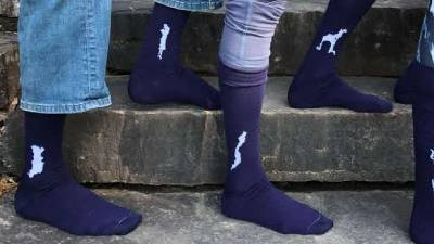 socks with shapes of lakes on them