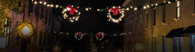street in saratoga decorated for the holidays