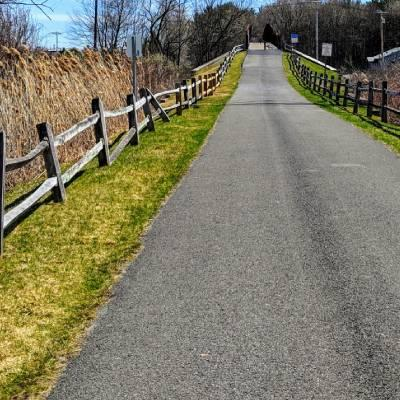 walking path with fencing on either side