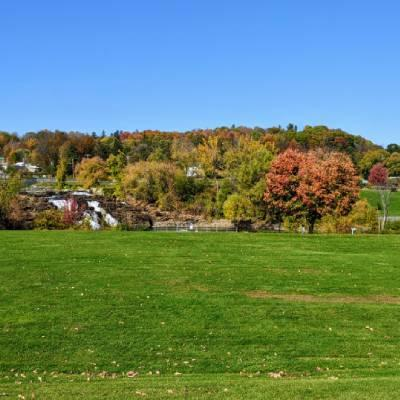 park in the fall with waterfall