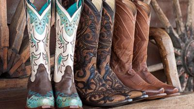 three pairs of cowboy boots in a row