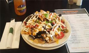 nachos, a menu, and a drink