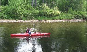 person in red kayak